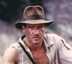 Hat, torn shirt, rugged countenance, staring into the middle distance; it's a movie archaeologist, alright!